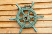 Old sea steering wheel — Stock Photo