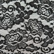 Stock Photo: Background from black lace with pattern with form flower