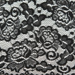 Background from black lace with pattern with form flower — Stock Photo #4118474