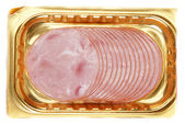 Meat in golden packing — Stock Photo