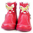 Pair red leather baby boots — Stockfoto
