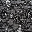 Background from black lace with pattern with form flower — Stock Photo