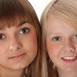 Portrait two girls of the blonde and brunettes — Stock Photo