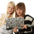 Stock Photo: Two beautiful girls read diary book