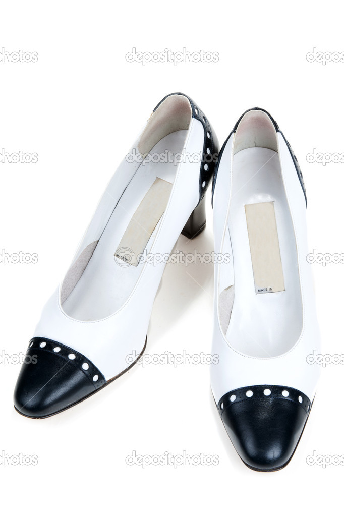 White feminine varnished loafers on white background — Stock Photo #4504748