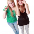 Two girls stand and make faces — Stock Photo #4567005