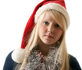A beautiful young blonde in a Santa hat — Stock Photo