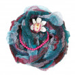 Varicoloured scarf is put with necklace around and flower — Stock Photo #4574971