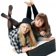 Two girls lies with computer — Stock Photo