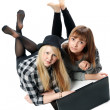 Two girls lies with computer — Stock Photo #4575206