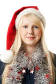 A beautiful young blonde in a Santa hat — Zdjęcie stockowe