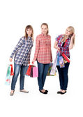 Three girls with colorful shopping bags — Stock Photo