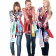 Stock Photo: Three girls with colorful shopping bags