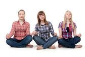 三个女孩坐在莲花的姿态 — 图库照片