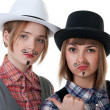 Two girls with painted mustaches — Stock Photo