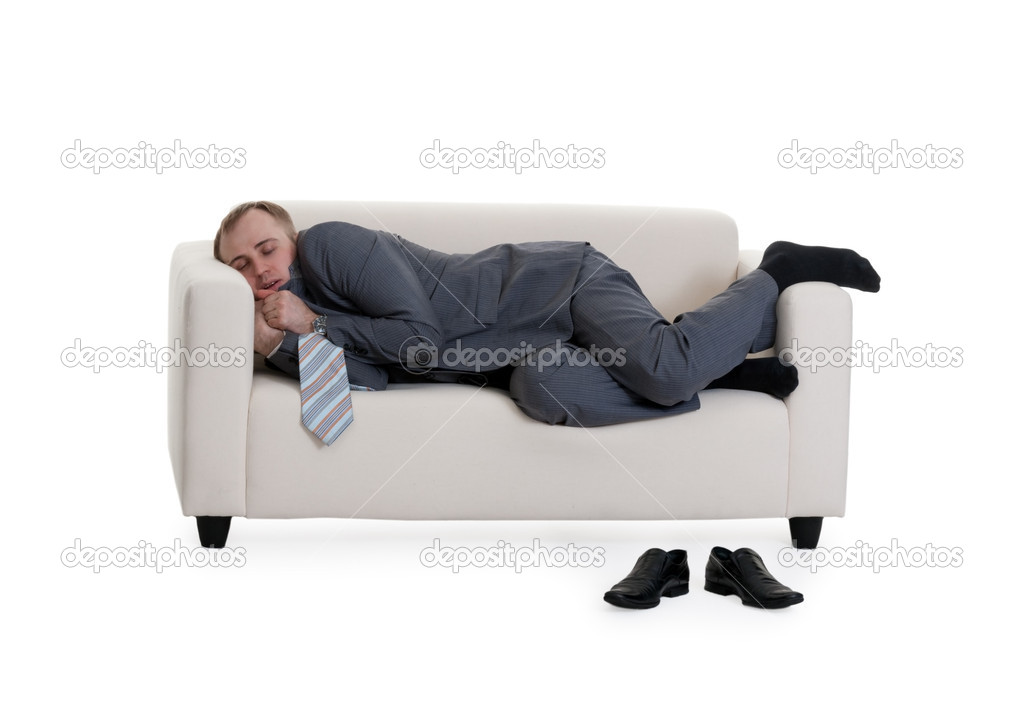 Businessman sleeping on a sofa on a white background  Stock Photo #5151160