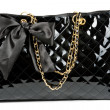 Black glossy women's handbag — Stock Photo