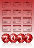 2011 calendar with christmas balls — Stock Photo