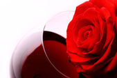 Rose and wine — Stock Photo