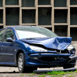 Crashed blue car — Stock Photo