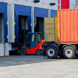 Stock Photo: Unloading trucks