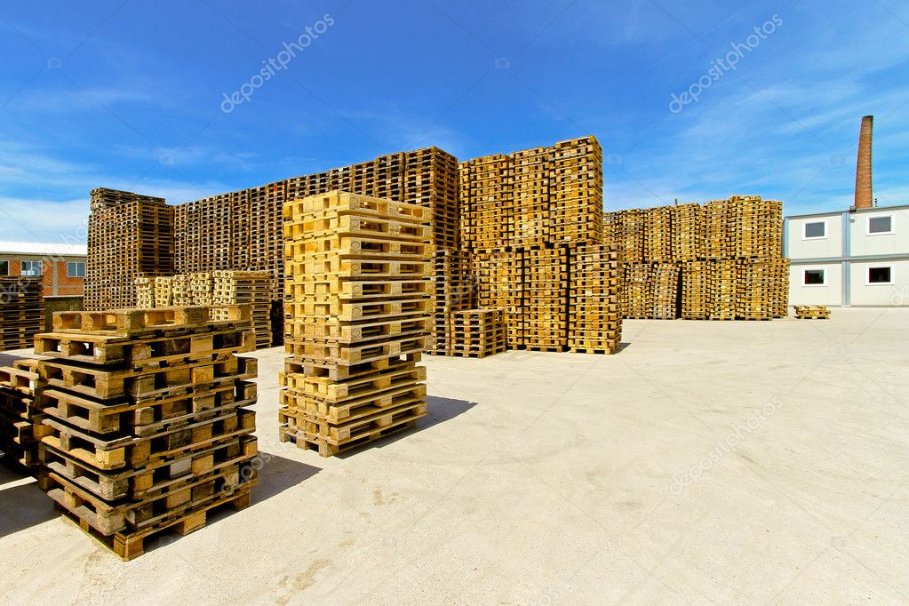 Pallets stacks for cargo and logistic at warehouse — Stock Photo #4377892