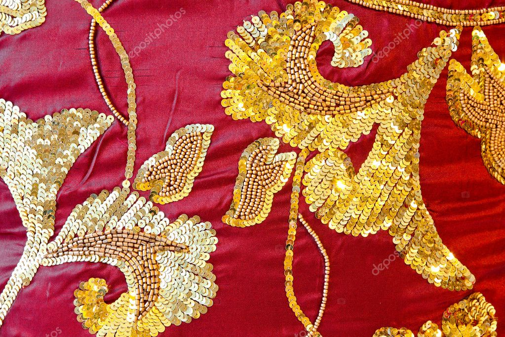 Detail of burgundy silk texture with gold glittering ornaments — Stock Photo #4387294
