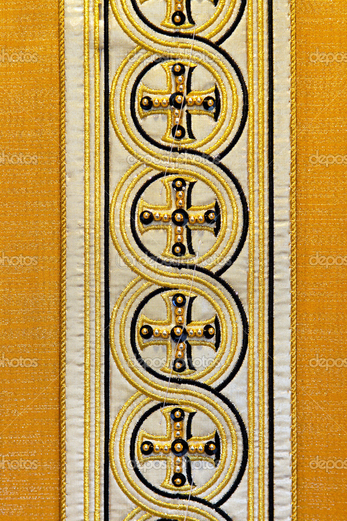 Golden holy pattern at traditional Catholic dress — Stock Photo #4442950