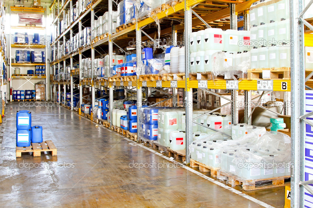 Long rack in warehouse with chemical liquids — Stock Photo #4529694