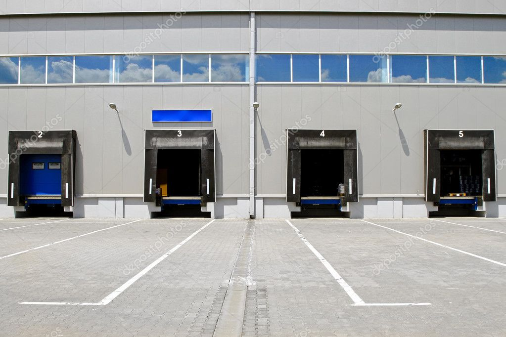 Several cargo door ramp at warehouse building — Stock Photo #4636456