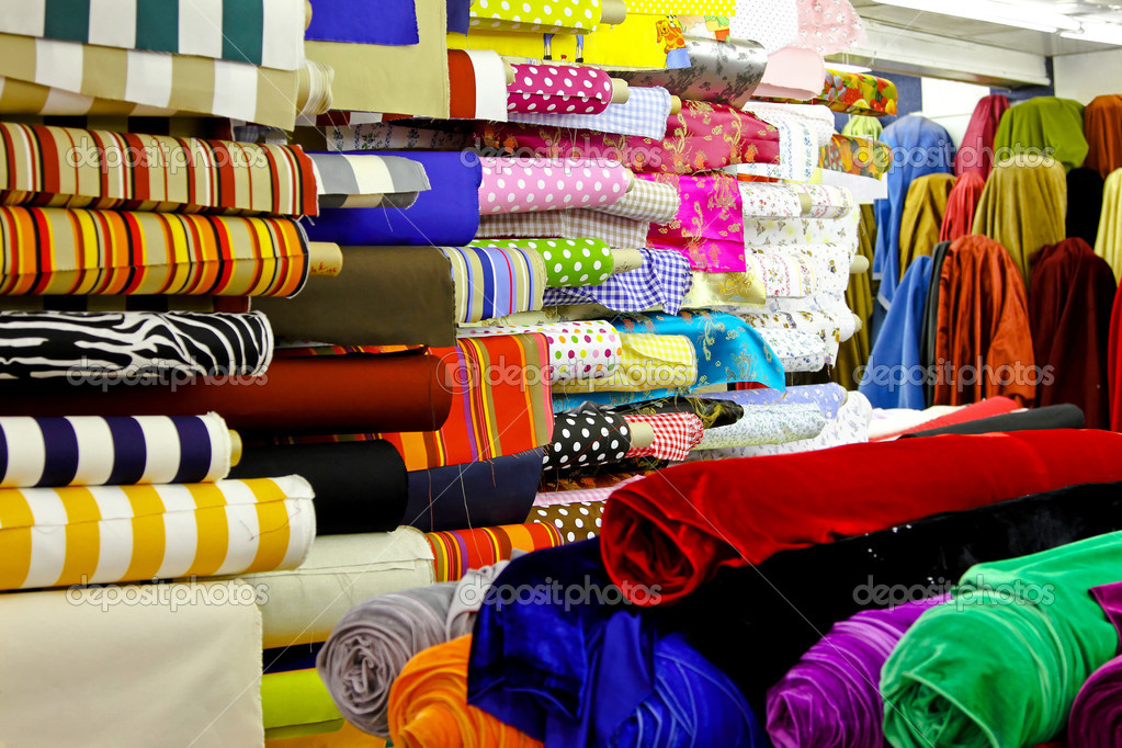 Assortment of colourful textile fabric rolls in warehouse — Stock Photo #4767573