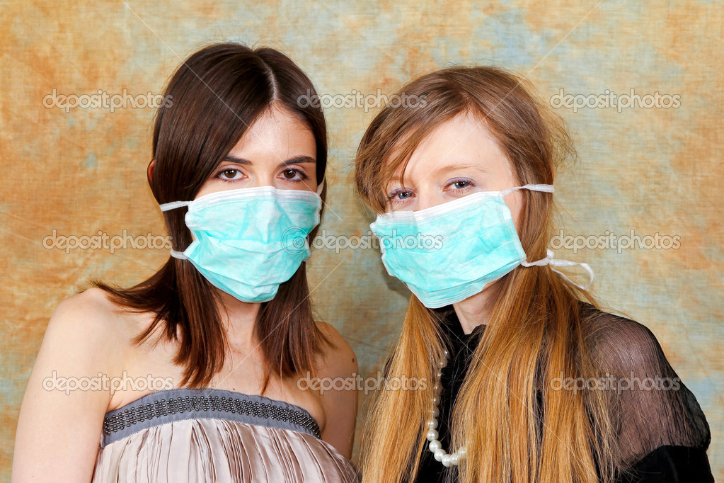 Two fashion girls with protective medical masks  Stock Photo #4782765