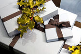 Holly gifts — Stock Photo