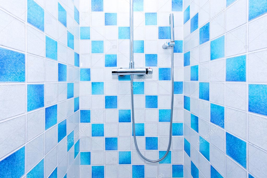 Inside of shower with blue and white tiles  Stock Photo #4875197