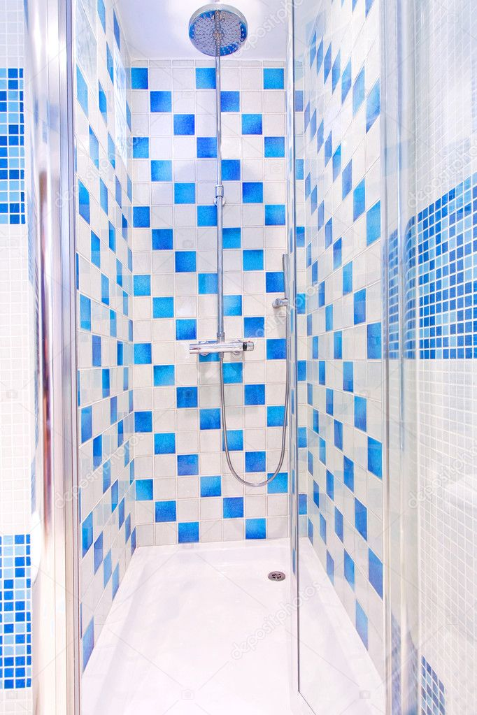 Interior of shower with blue and white tiles — Stock Photo #4879109