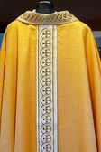 Catholic golden dress — Stock Photo