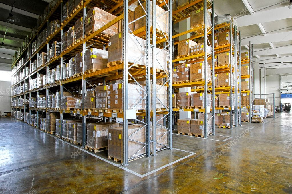 Shelves and racks in distribution warehouse interior  Stock Photo #5078916
