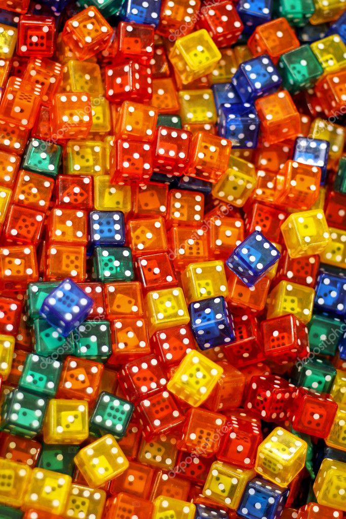 Big pile of plastic colorful dices with another dice inside — Stock Photo #5352087