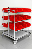 Supply red cart — Stock Photo