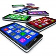Many Smart Phones with Apps on Touch Screens - Stock Photo