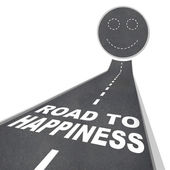 Road to Happiness - Smiling Face in Street Pavement — Stock Photo