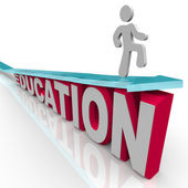 Education - Man Rides Arrow Over Word — Stock Photo