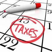 Calendário - dia do imposto dentro de um círculo — Foto Stock