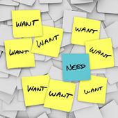 Wants vs behoeften - kleverige nota 's — Stockfoto
