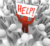 Person Holding Help Sign in Crowd — Stock Photo