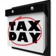 Tax Day - Words Circled on Wall Calendar — Stock Photo #4925275