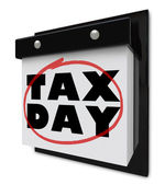 Tax Day - Words Circled on Wall Calendar — Stok fotoğraf