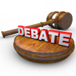 Debate - Judge Gavel and Word - Stock Photo