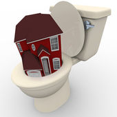 House Flushing Down Toilet - Falling Home Values — Stock fotografie