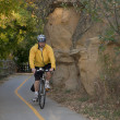Riding a bike on scenic trail — Stock Photo